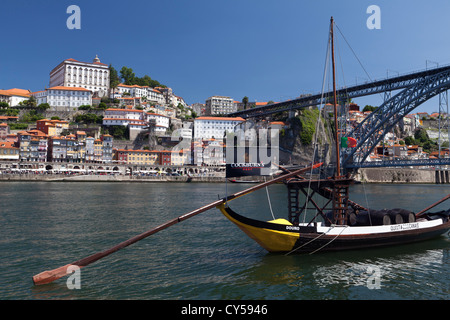 The Douro river, Port wine barges and the historic Ribeira district of Porto (Oporto), Portugal - Stock Photo