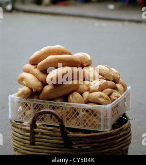 Bread for sale in the streets of the Old City of Hanoi in Vietnam in Far East Southeast Asia. Food Basket Quarter - Stock Photo