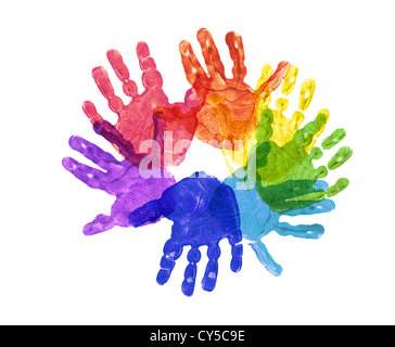 a flower made out of children's hand prints in rainbow colours. - Stock Photo