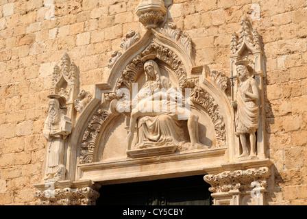 croatia, dubrovnik, old town, franciscan monastery, detail of the door, pieta of the 15th century - Stock Photo
