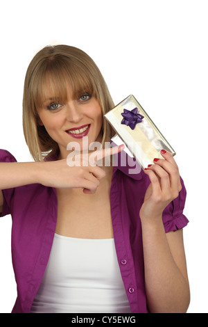 Woman holding a present - Stock Photo