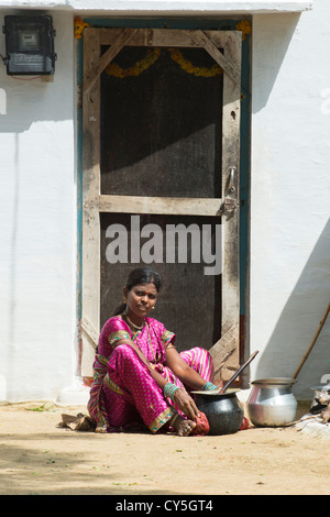 Indian woman mixing dal for Dasara festival food in a rural Indian village. Andhra Pradesh, India - Stock Photo