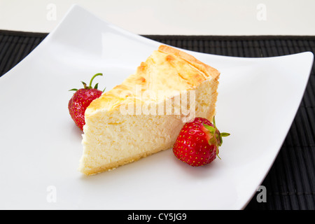Cheesecake with strawberries and coffee - Stock Photo