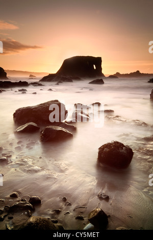 Elephant rock on the Antrim coast captured at dusk. - Stock Photo