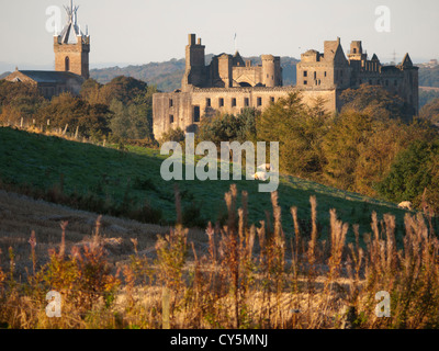 Linlithgow Palace and St Michaels church looking from the north east. - Stock Photo