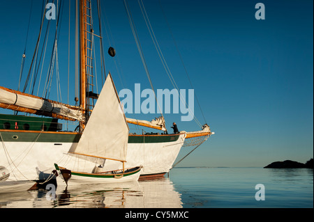 The tall ship 'Zodiac' and a small sailboat anchor off of Shaw Island in the San Jaun Islands of Puget Sound, Washington, - Stock Photo