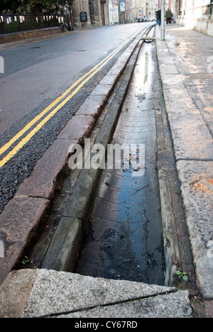 Sluices in Trumpington Street, Cambridge that form part of Hobson's Conduit - Stock Photo