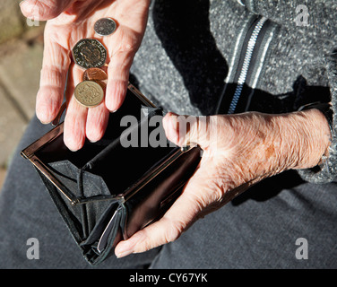 Pensioner with purse - Stock Photo