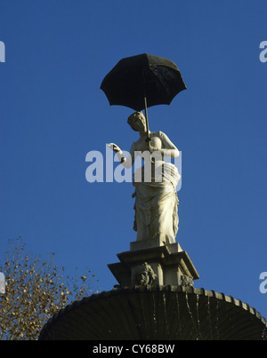 Joan Roig Soler (1852-1909). Spanish sculptor. The lady of the umbrella, (1884). Citadel Park. Barcelona. Catalonia. - Stock Photo