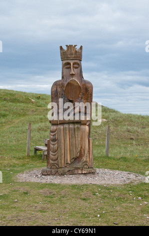 Sculpture of the King chess piece from the 'Isle of Lewis Chessmen' that were found on the nearby Uig Beach - Stock Photo
