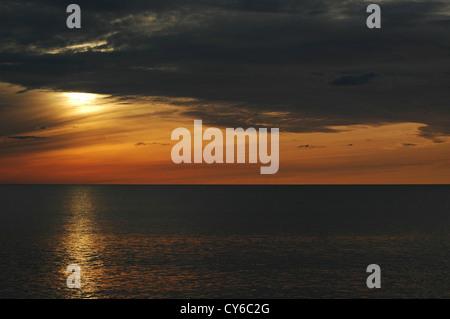 Sunset over Aberystwyth and Cardigan Bay - Stock Photo