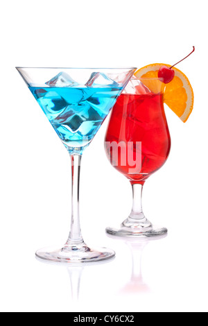 Two tropical cocktails: blue and red. Isolated on white background - Stock Photo