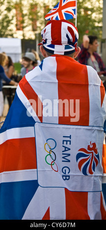 A man wrapped in a Union jack flag during London 2012 Olympic games Stratford London England Europe - Stock Photo