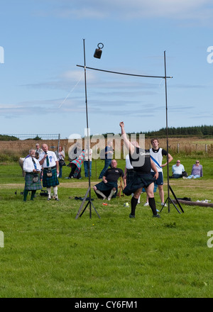 Weight Over the Bar competition at Highland Games in Mey, Caithness - Stock Photo