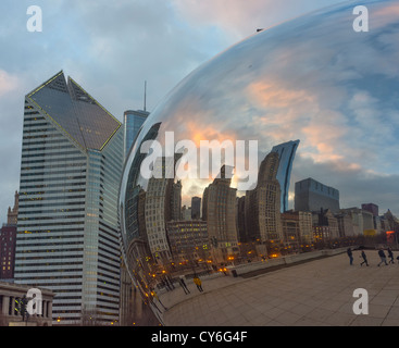Chicago, Illinois Cloud Gate aka 'The Bean' reflects the city skyline with the Smurfit-Stone Building, in Millennium - Stock Photo