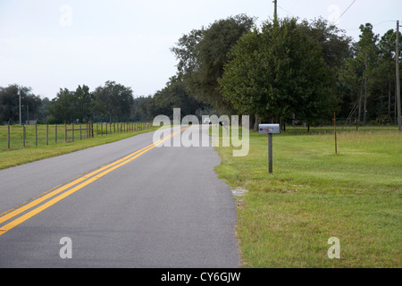 mailboxes on a small rural road florida usa - Stock Photo