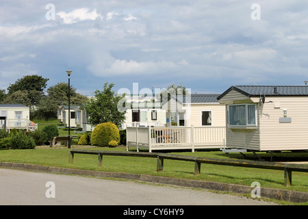Scenic view of caravan trailer park with road in foreground. - Stock Photo