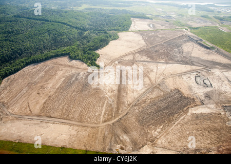 Soil overburden being removed to reach the tar sands beds in an open pit tar sands mine north of fort McMurray, - Stock Photo