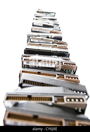 high stack of used hard drives in light background - Stock Photo