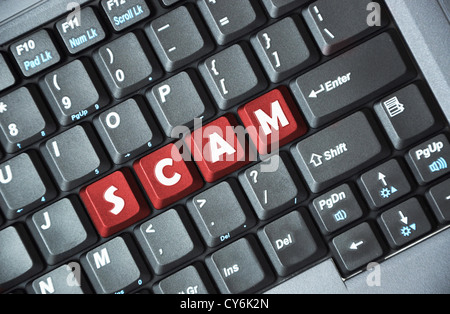Scam on keyboard - Stock Photo