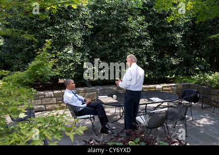 US President Barack Obama and Vice President Joe Biden have lunch on the patio outside the Oval Office August 30, - Stock Photo