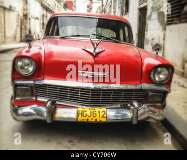 Red Vintage American Car on the streets of Havana, Cuba. - Stock Photo
