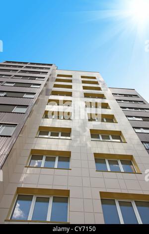 inhabited high house against the blue sky - Stock Photo