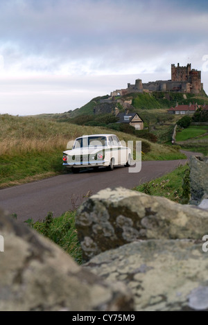 1965 Ford Lotus Cortina at Bamburgh castle Nothumberland UK - Stock Photo