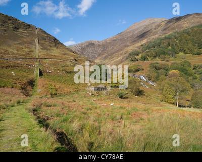 Snowdonia National Park North Wales October Afon Cwm Llan waterfall flows down alongside Watkin Path from mountains - Stock Photo