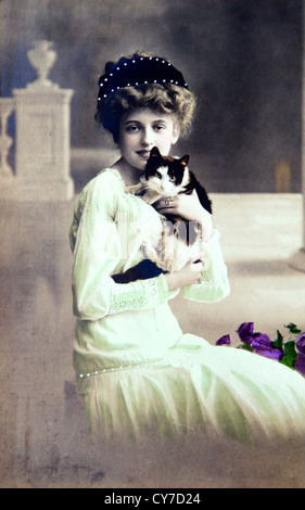 Womens fashion 1900s hand coloured photo postcard England - Stock Photo