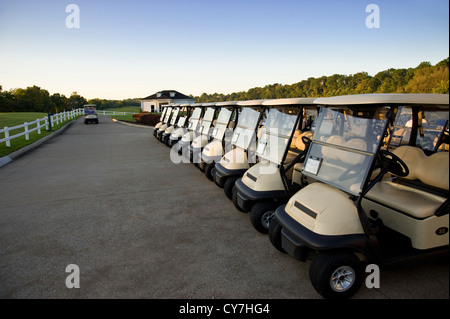 Row Of Golf Carts On Golf Course, Florida, USA - Stock Photo