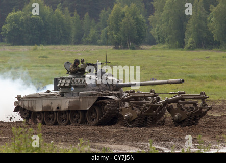 T-55M main battle tank of the Finnish Army with KMT-5 mine clearing roller. - Stock Photo