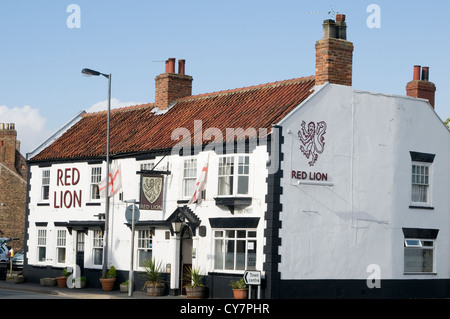 red lion english village pub uk public house pubs bar bars traditional boozer - Stock Photo