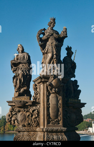 Statue on the historic Charles Bridge over the Vitava River in Prague, Czech Republic - Stock Photo