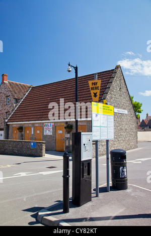 A Pay & Display machine and public disabled toilets in a car park in Wells, Somerset, England, UK - Stock Photo