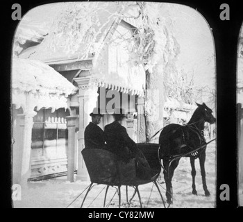 Two People Riding in Horse-Drawn Sleigh, Stereo Photograph, Circa 1900 - Stock Photo