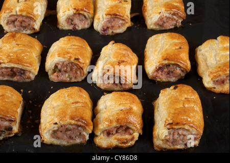 Freshly baked homemade sausage rolls - Stock Photo