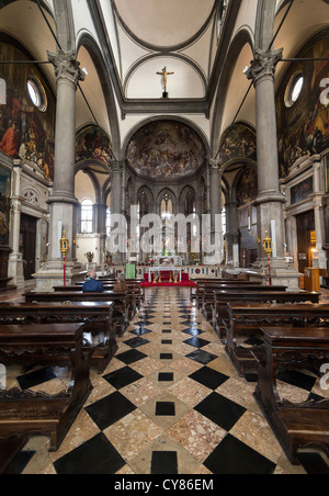 Interior of the Chiesa di San Zaccaria in Venice showing the nave, the tiled floor and the walls richly decorated - Stock Photo