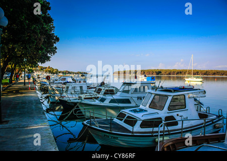 Small boats tied up in harbor on a sunday morning in Punat on Krk island Croatia - Stock Photo