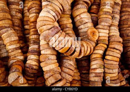 Close up of dried figs on a string in a traditional souk street market, Marrakesh, Morocco - Stock Photo