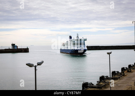 Ferry entering Dover harbor from France - Stock Photo
