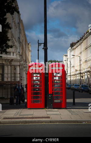 Typical red phone booths in the city of London - Stock Photo