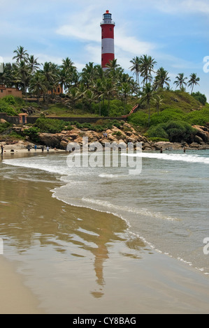 Vertical view of the red and white striped Vizhinjam Lighthouse on Lighthouse beach in Kovalam, Kerala. - Stock Photo