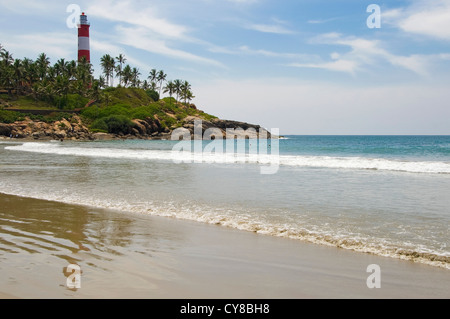 Horizontal view of the red and white striped Vizhinjam Lighthouse on Lighthouse beach in Kovalam, Kerala. - Stock Photo