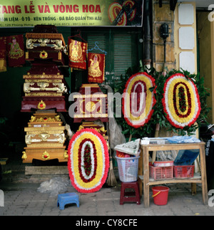 Funeral undertaker in the Old City of Hanoi in Vietnam in Far East Southeast Asia. Coffin Wreath Death Business - Stock Photo
