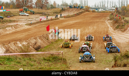 Small buggy test race. Karts on start. - Stock Photo