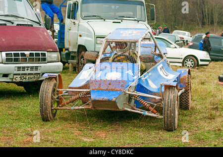 The blue buggy-cart on autorace camping. - Stock Photo