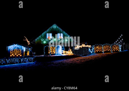 House decorated with Christmas lights at night. - Stock Photo