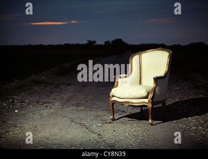 antique chair let on the road - Stock Photo
