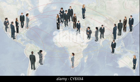 Large group of business people standing on world map - Stock Photo